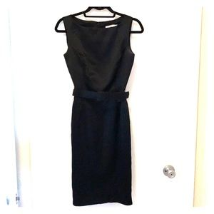 Black satin dress. Appropriate for cocktail party